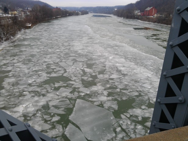 Ice flowing north on the Mon.