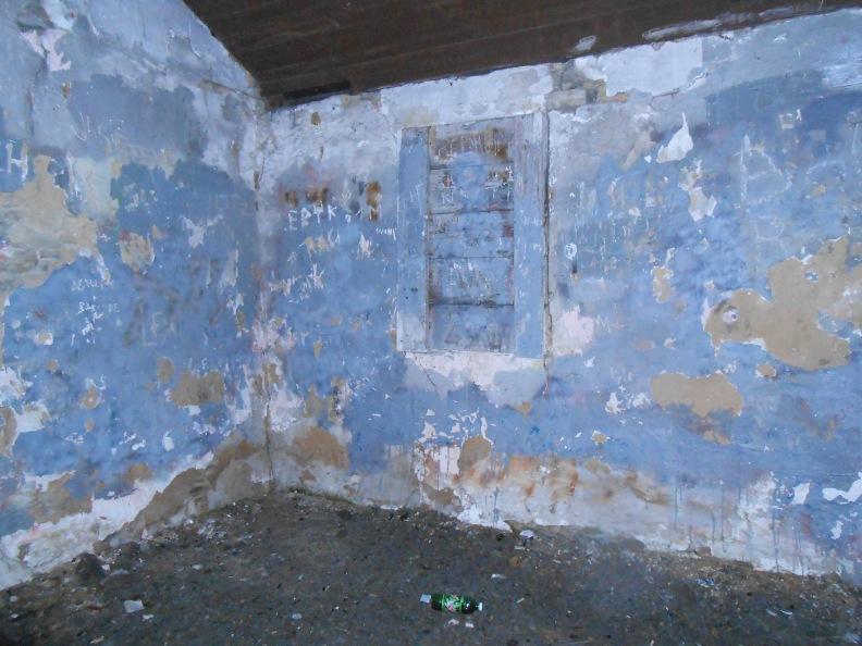 Back wall, boarded window